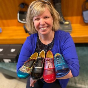 """Darby holding 4 different pairs of John Fluevog """"Darby"""" Shoes Picture"""